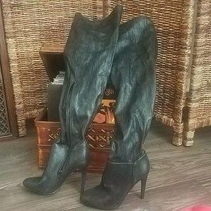 Thigh high heeled boots
